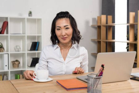 businesswoman with laptop and coffee