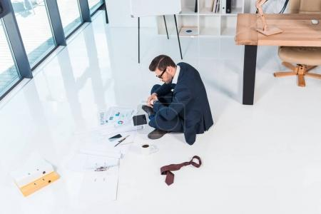 businessman working with papers and devices
