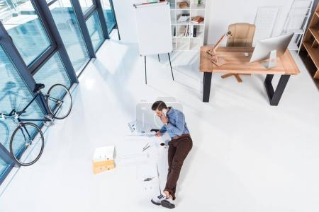 businessman with smartphone and documents