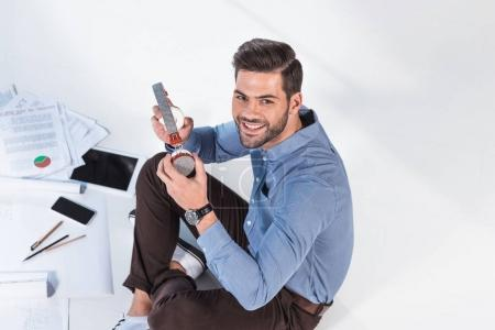 businessman with headphones working with papers