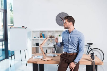businessman with coffee in office