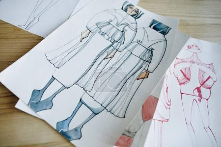 Photo for Close-up view of fashion sketches on wooden table - Royalty Free Image