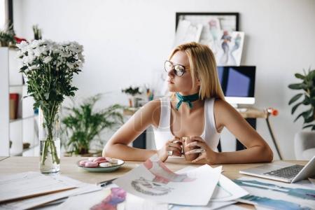 fashion designer drinking coffee