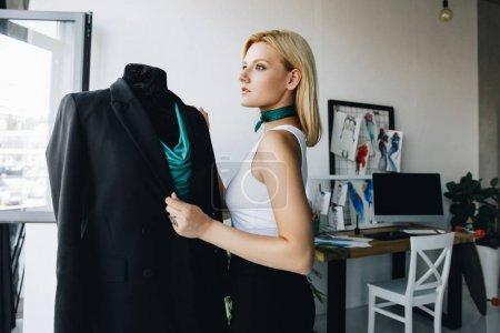dressmaker working with dummy
