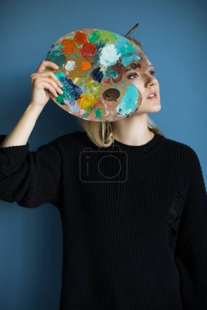 Beautiful girl with palette