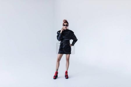 Girl in black leather dress