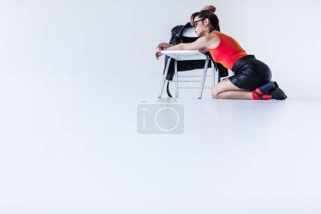 fashionable girl posing at chair
