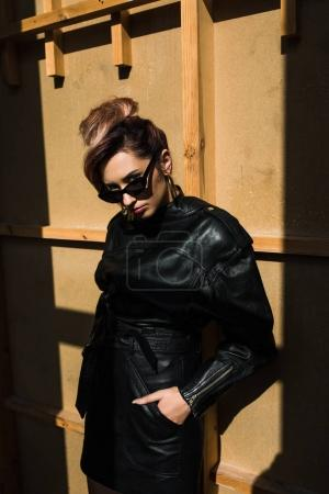 stylish girl in leather clothes