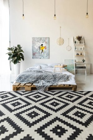 Photo for Empty bedroom with wooden tray and breakfast on bed - Royalty Free Image