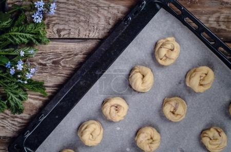 Raw buns on baking tray