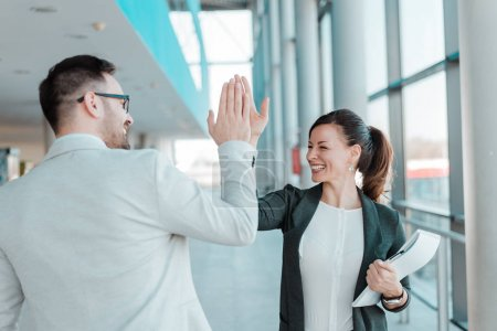 Two business people high-five