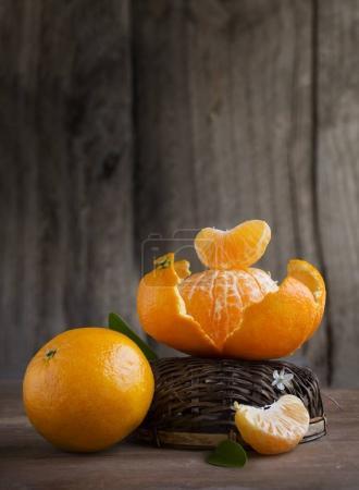 fresh tangerines with upturned basket
