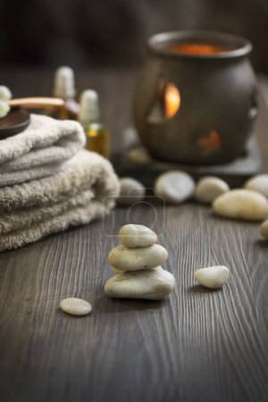 towels and candle in spa center