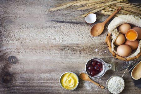 Photo for Ingredients and utensil for baking on wooden tabletop - Royalty Free Image