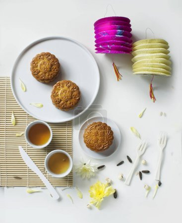 Photo for Top view of cookies and cups with green tea on decorated table. - Royalty Free Image