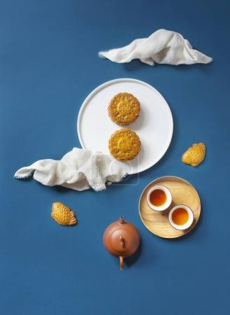 Photo for Top view of artistic table setting with tea and sweet cookies - Royalty Free Image