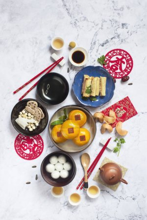 Flat lay Chinese new year food and drink. Text appear in image: Prosperity.
