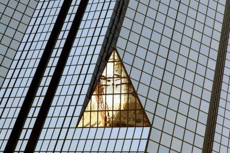 A reflection of a glass building
