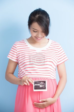 pregnant woman holding ultrasound picture