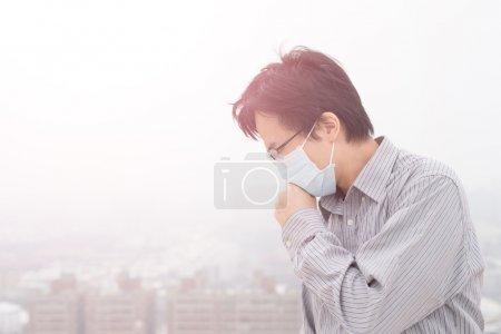 asian man wearing mask.