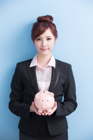 woman take pink piggy bank