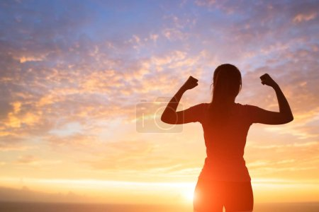 silhouette of woman feel free