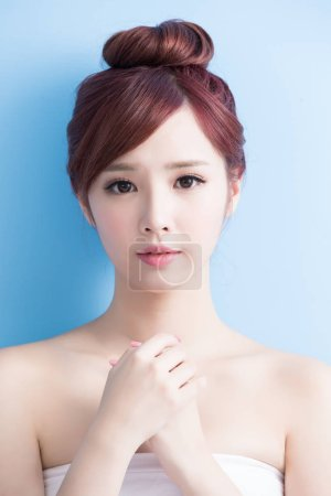 Photo for Beauty  skin care woman smile to you isolated on bluebackground, asian - Royalty Free Image