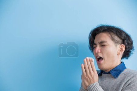 man is sick and sneezing