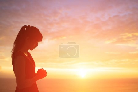 Photo for Young woman praying  pious with sunrise, asian - Royalty Free Image