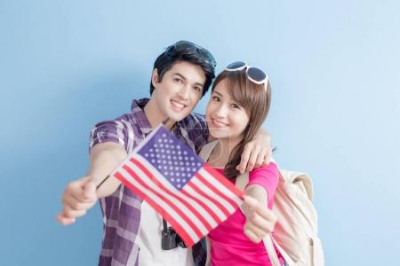 Young couple with  american flag