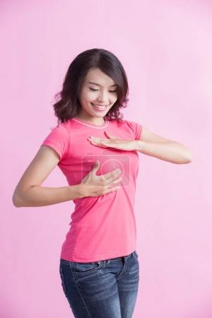Photo for Happy woman checking  her chest, great for prevention breast cancer concept - Royalty Free Image
