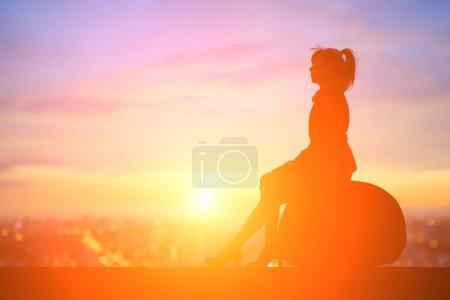 Business woman sitting  on stone