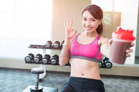 woman with protein  showing ok sign