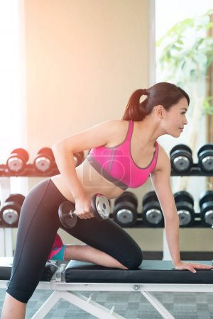 woman with dumbbell training