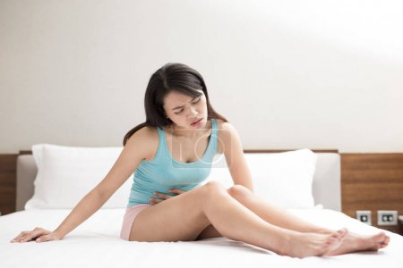 woman feeling  pain with menstruation