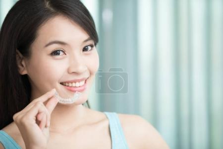 woman smiling  with invisible braces