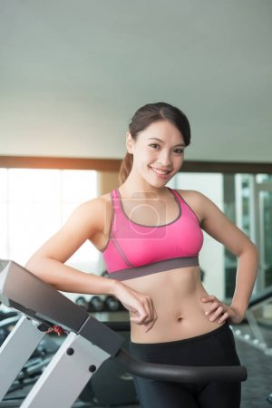 woman  standing  on treadmill