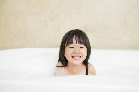 cute girl taking  bath