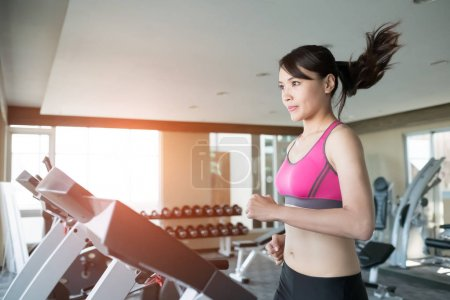 woman running  on treadmill i