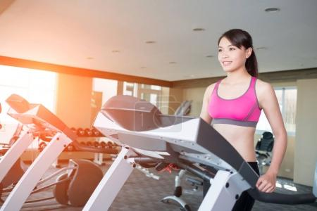woman stand on treadmill