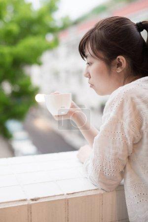 woman drinking tea next
