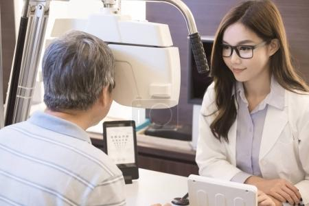 old man with optometrist