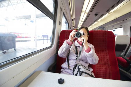 woman taking  picture in the train