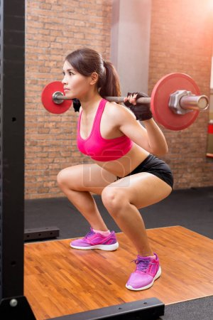 sport woman with barbell