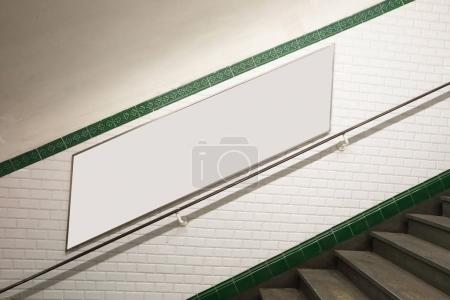 metro staircase with billboard