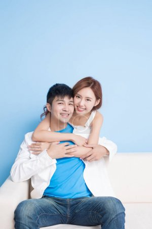 couple smiling  happily on the blue background