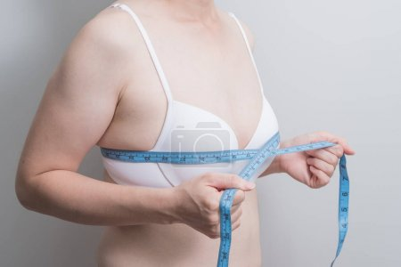 Fat overweight woman with  measurement tape