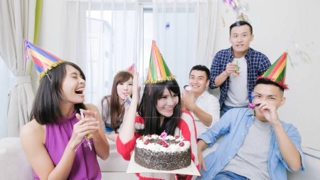 people smiling  happily on  birthday party at  home