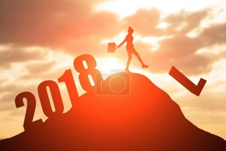 silhouette of businesswoman on the moutain with 2018