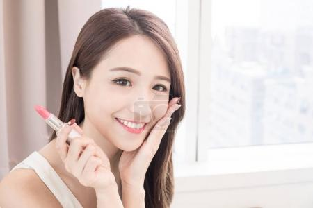 beauty skincare woman with e lipstick at  home
